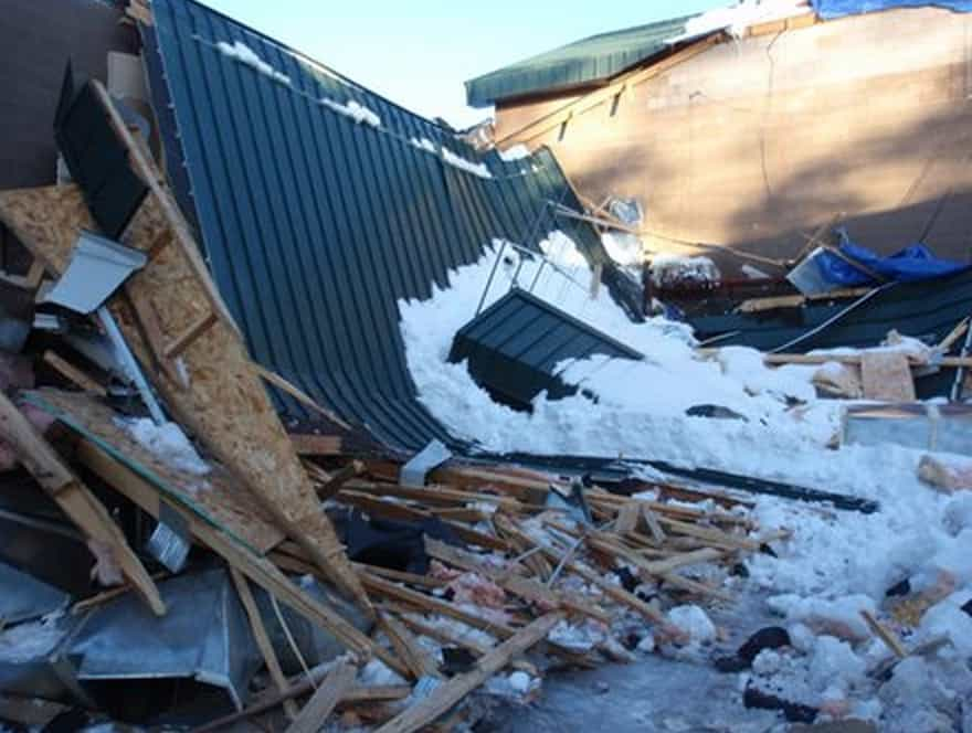 Snow and ice build up causing demolished roof